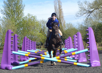 A happy rider from Willow Farm Pony Club uses the new jumps.