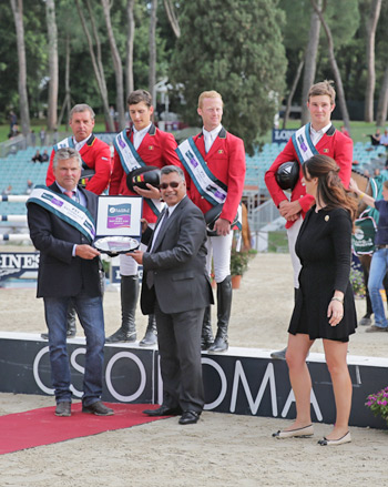 The Belgian team enjoyed their first victory in Rome when winning the third leg of the Furusiyya FEI Nations Cup Jumping Europe Division 1 league.  Pictured on the podium are: (L-R) Ludo Philippaerts, Nicola Philippaerts, Niels Bruynseels and Constant van Paesschen. At front, from left, is Belgian Chef d'Equipe Kurt Gravemeier, Dr Adil Nofal, Kingdom of Saudi Arabia's Deputy Ambassador to Italy and Mrs Eleonora di Giuseppe, Coordinator CSIO Rome.