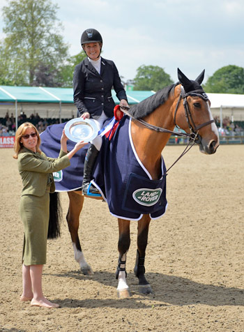 Speed class winner Laura Renwick and Beluga receive their trophy.