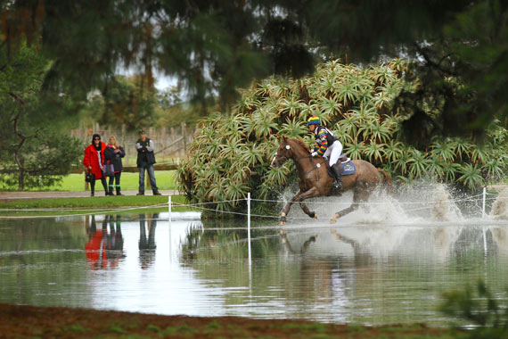 Megan Jones powers through the ornamental lake on KP Allofasudden at the Melbourne International Horse Trials.