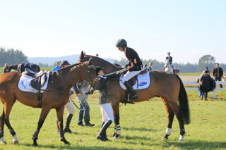 Second-placegetter Tayla Mason on Royalty congratulates Amanda Pottinger for her win on Just Kidding in the CCI1*.