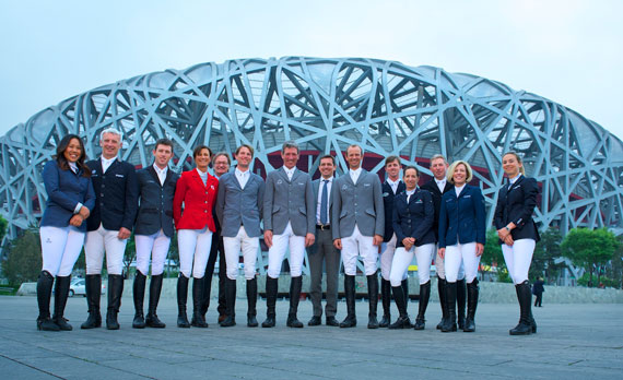 "International riders together with Michael Mronz and Frank Kemperman in front of the ""Bird's Nest"" Olympic Stadium, from left, Meimei Zhu (CHN), Roger-Yves Bost (FRA), Scott Brash (GB), Penelopes Leprevost (FRA), Frank Kemperman (NL), Kevin Staut (FRA), Ludger Beerbaum, Michael Mronz, Marco Kutscher (all from Germany), Ben Maher (GB), Laura Kraut (USA), Nick Skelton (GB) and Jane Richard Philips (SUI)."