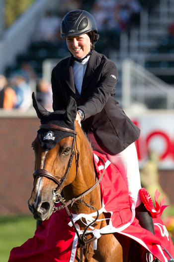 "Caitlin Ziegler, pictured at the 2011 Spruce Meadows ""North American"" tournament when she became the youngest rider to win an FEI-sanctioned event in the International Ring at age 16."