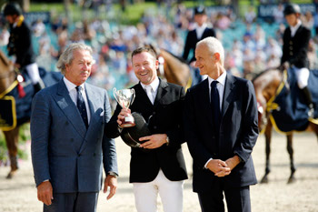 Eric Lamaze receives the trophy for the €200,000 Grand Prix of Rome.
