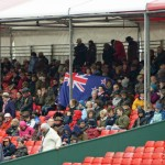 Kiwi supporters brave the elements.
