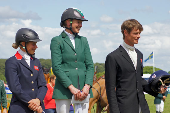 Aoife Clark, center, with Izzy Taylor and William Fox-Pitt on the podium.