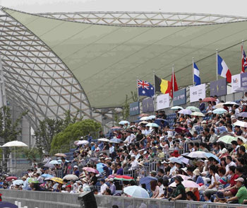 Spectators enjoy the first ever showjumping event with international horses in China.