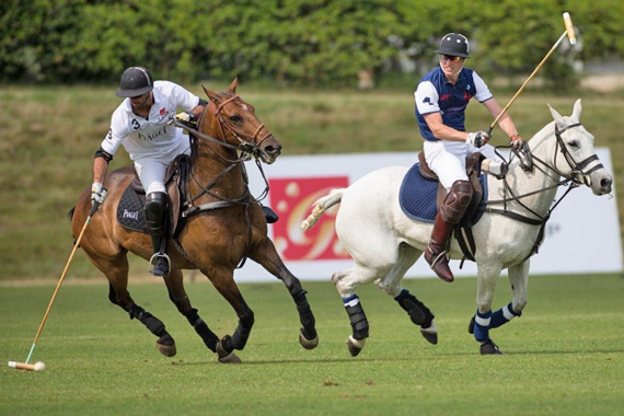 Piaget team's Facundo Pieres and Royal Salute team's Prince William go head to head.