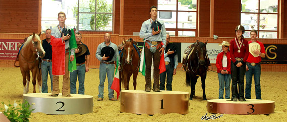 On the podium for the Junior Individual Championship at the FEI European Reining Championships for Juniors and Young Riders 2014 at Givrins, Switzerland, L-R: Eric Ranieri Volpe ITA (silver), Enrico Sciulli ITA (gold) and Gina Maria GER (bronze).