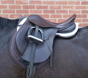 Image shows the seat of the saddle tips backwards which, with a rider, results in abnormal pressure under the back of the saddle. The numnahs tend to ruckle up behind the saddle.