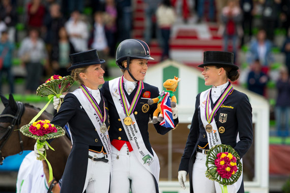Medal winners on the podium after the thrilling Dressage Grand Prix  Special, L-R: Germany's Helen Langehanenberg (silver), Great Britain's Charlotte Dujardin (gold) and Germany's Kristina Sprehe (bronze).