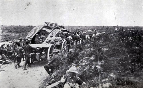 A horse-drawn team passes a tank that seems to have broken down on the side of the road. Over 100,000 British horses were estimated to have been killed in the Somme offensive.