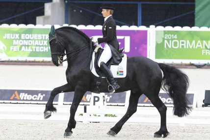 Chere Burger and Adelprag Anders perform their dressage test on the first day of the Games.