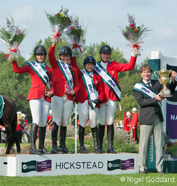 Team USA on the podium, from left: Reed Kessler, Beezie Madden, Margie Goldstein-Engle, and McLain Ward.
