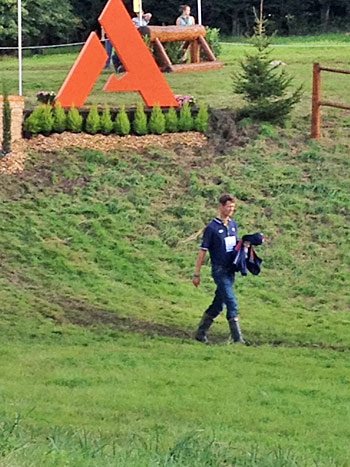 Current dressage leader William Fox-Pitt goes it alone walking the course.