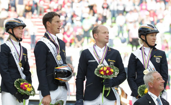 Germany's gold medal winning team, from left, Sandra Auffarth, Dirk Schrade, Michael Jung, and Ingrid Klimke.