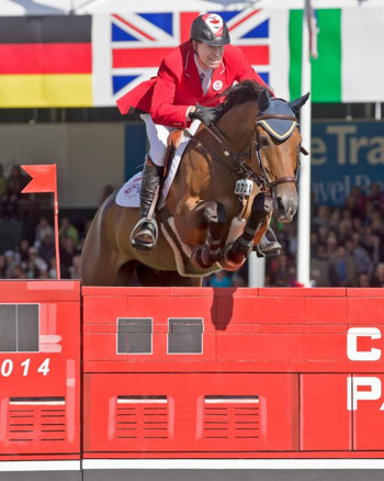 Ian Millar and Dixson on their way to winning the 1.5 Million CP International at Spruce Meadows.