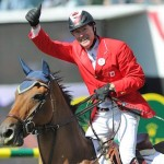 Ian Millar celebrates after he and Dixson won the $C1.5 million CP International at Spruce Meadows.