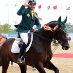 Saudi Arabia's team silver medalist Prince Faisal Alshalan and Talan during their lap of honour in Incheon.