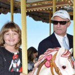 Rebecca Lawlor and George Morris take a spin on the new hand painted Venetian Carousel in the public plaza of the Tryon International Equestrian Center.