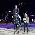Great Britain's William Whitaker pictured with Longines representative Christiane Becherer after his victory with Fandango in the Longines FEI World Cup Western European League qualifier at Stuttgart, Germany.