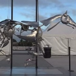 Horse sculpture moves in a slow-motion gallop