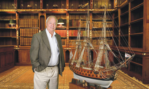 The author, John Amrhein, Jr., with a model of the 56-gun warship, La Galga, which drove ashore on Assateague Island, Virginia, on September 5, 1750.