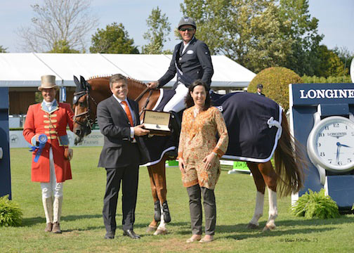 Juan-Carlos Capelli, vice president of Longines, and Hampton Classic Executive Director Shanette Cohen present a Longines timepiece to Paul O'Shea, winner of the $40,000 Longines Cup at the Hampton Classic.