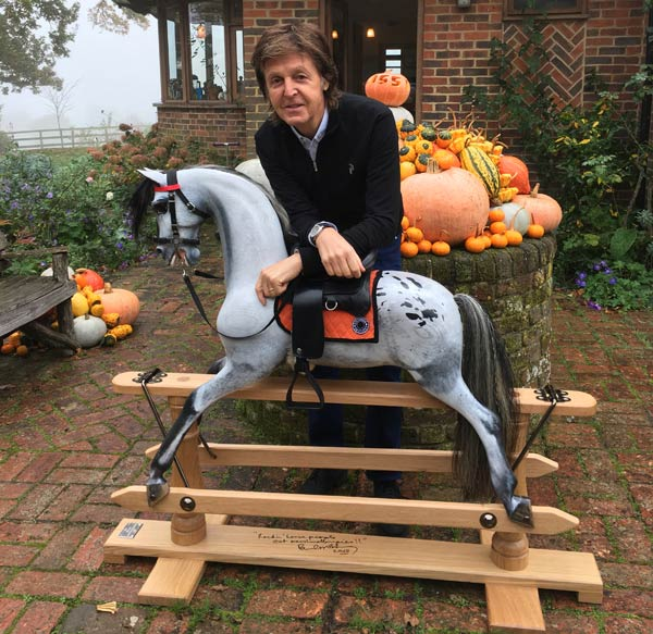 Paul McCartney with the Moonstar rocking horse made by the Stevenson Brothers.